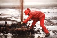 Workers attempt to extinguish oil field fires